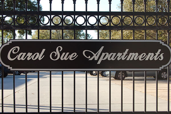 Carol Sue Gate with Apartment Logo